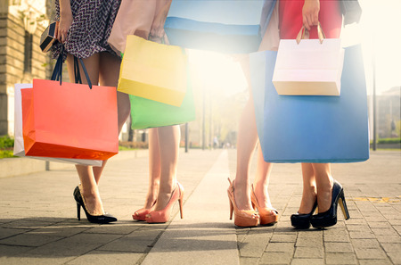 woman close up: High heels and shopping bags