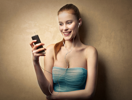 woman on phone: Blonde woman using a smart phone Stock Photo