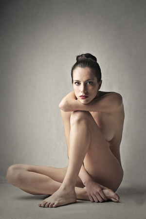 naked woman sitting: Naked woman sitting on the ground Stock Photo