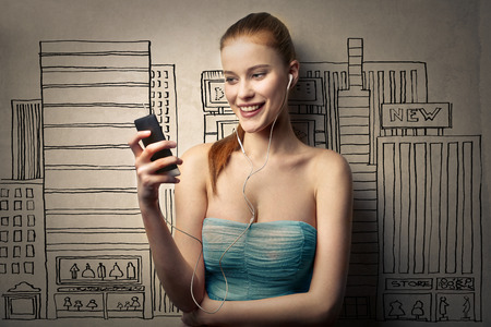 woman on phone: Blonde woman using her smart phone