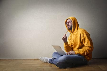 man working computer: Man thinking of something Stock Photo