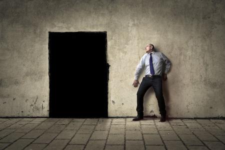 hombre: tratando de escapar Foto de archivo