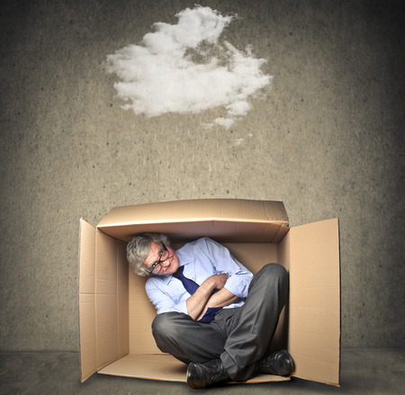 wheather: Businessman hiding from a cloud sitting in a small box