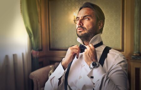 arrogant: Elegantly dressed businessman Stock Photo