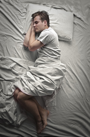 pillow sleep: Young man sleeping in bed