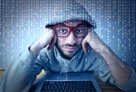 Bored man standing in front of a computer screen