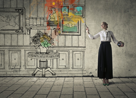 Woman painting a living room