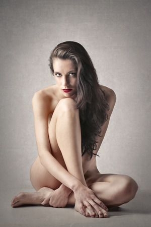 nude girl sitting: Naked woman sitting on the ground Stock Photo