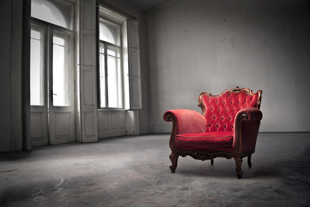 baroque room: Red chair in the middle of an empty room Stock Photo
