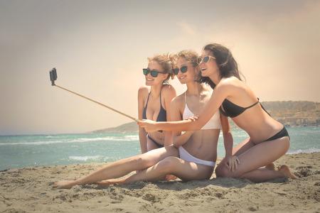 Three girls doing a selfie at the beach
