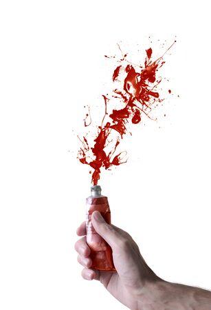red tube: Mano apretando un pequeño tubo de pintura roja