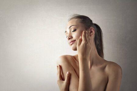 white women: Young woman caressing her skin