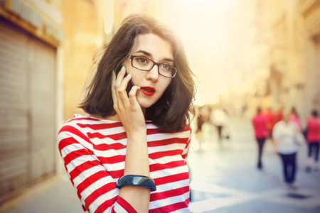 Young woman doing a phone call Stock Photo