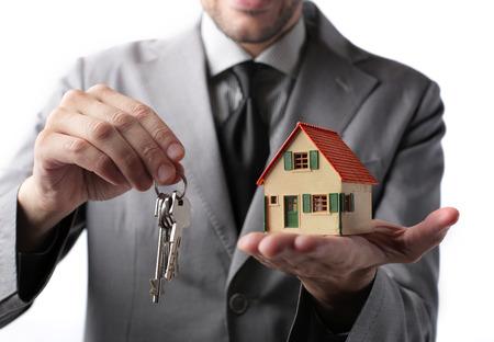 working hands: Businessman holding home keys