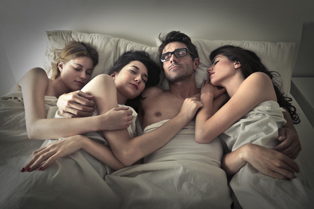 three persons: Man sleeping with three women