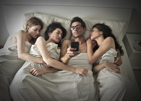 human relationships: Man sleeping with three women