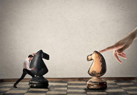 hard work: Businessman playing chess against an unknown player