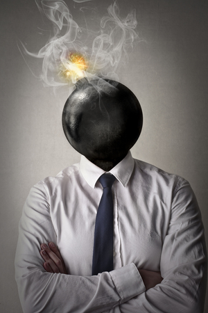 glut: Businessman with a bomb instead of her head Stock Photo