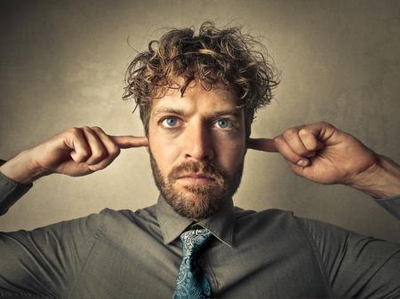 anger: Deaf businessman Stock Photo