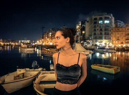 boat party: Young woman spending the night out at the harbor