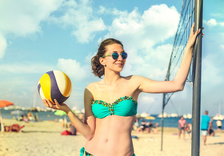 beach volley: Young woman playing beach volley