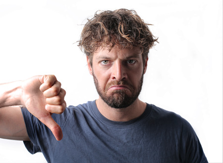 breaking off: Disappointed man with thumbs down Stock Photo