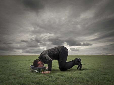 ironic: Desperate businessman with his face down in a bowl Stock Photo