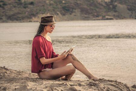 seach: Woman sitting at the beach