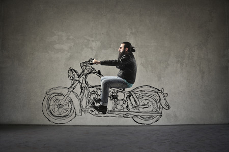 Man riding an imaginary motorbike Stock Photo