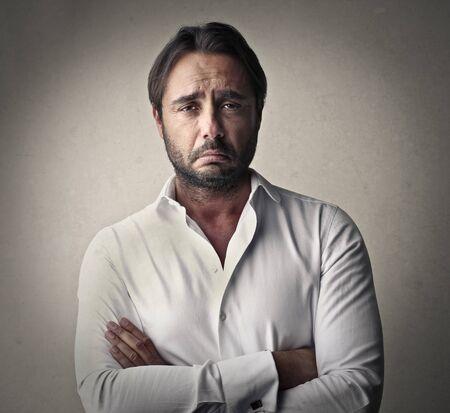 delusion: Sad businessmans portrait Stock Photo