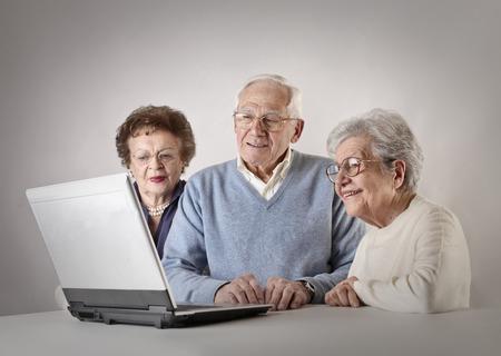 Elderly people using laptop photo
