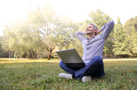 people relax: Relaxed businessman at the park Stock Photo