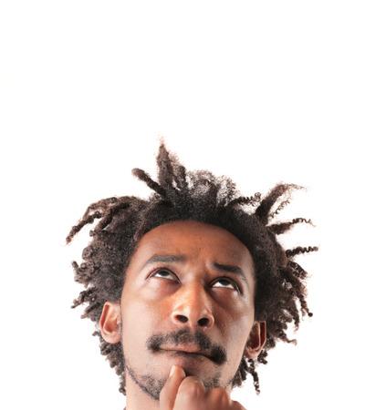 indecision: Black man thinking of something Stock Photo