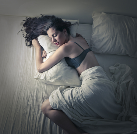 Beautiful woman asleep in her bed