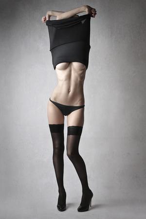 Beautiful woman undressing herself Stock Photo
