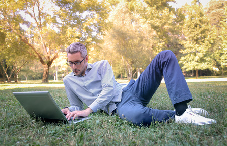 Young man working in the park