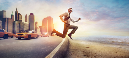 seaside: Running businessman Stock Photo