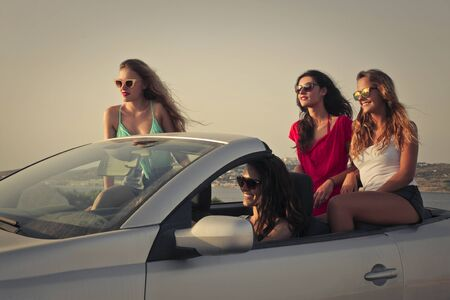 cabrio: Four girls travelling by car Stock Photo