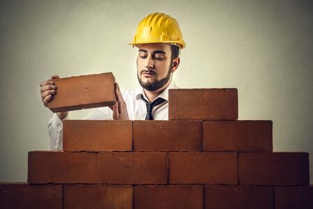 snort: Man building a wall Stock Photo