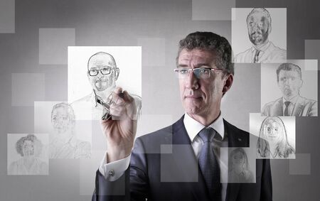 immagination: Businessman choosing his future colleagues Stock Photo