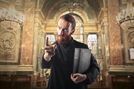 accuse: Priest judging someone