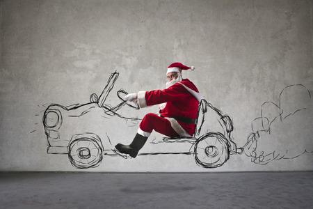 Santa Claus driving an imaginary car 스톡 콘텐츠