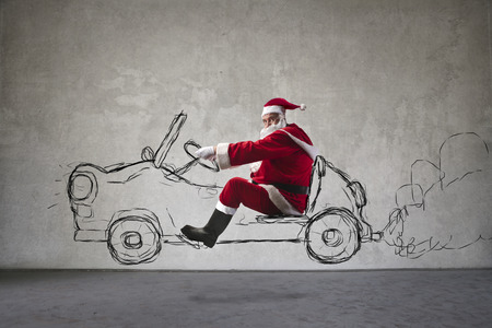 old cars: Santa Claus driving an imaginary car Stock Photo