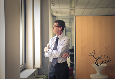 looking out: Businessman looking out of the window Stock Photo