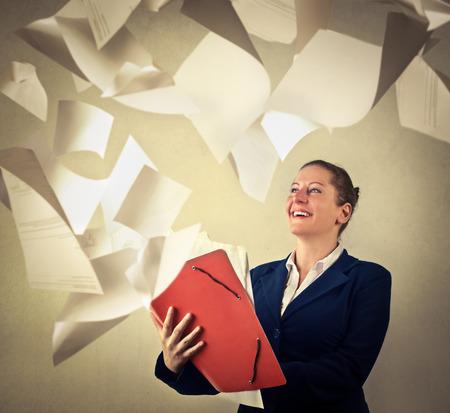 jubilate: Secretary throwing away sheets of paper Stock Photo
