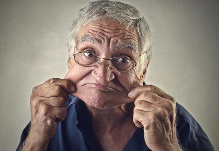 disdain: Elderly man making funny jokes