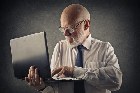 tricky: Serious man using a laptop Stock Photo