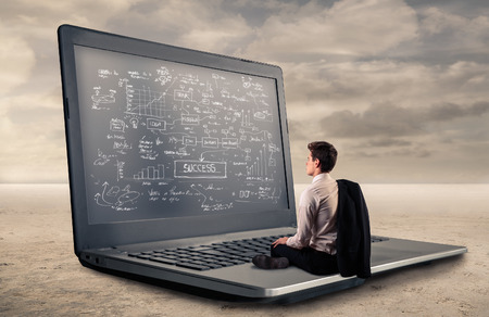 giant man: Young man sitting on a giant pc