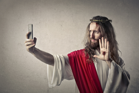 Jesus doing a selfie Фото со стока