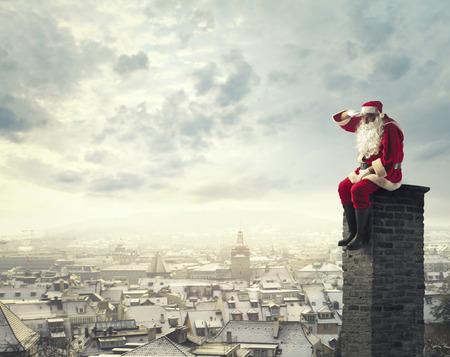 Santa Claus on a chimney Stockfoto